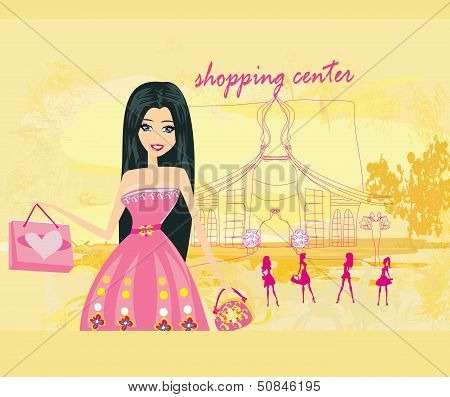 Cute Fashion Girl On A Shopping Center Background