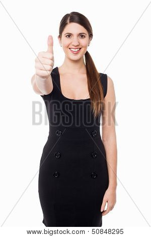 Attractive Female Gesturing Thumbs Up
