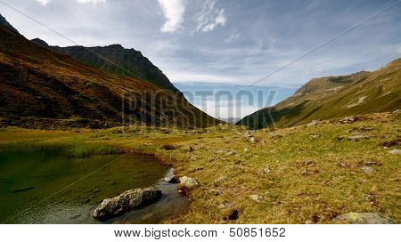 Bivouac At A Rest Place By The Lake In Alp Meadow In Swiss Alps