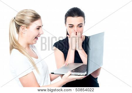 Excited Girls Watching Videos On Laptop