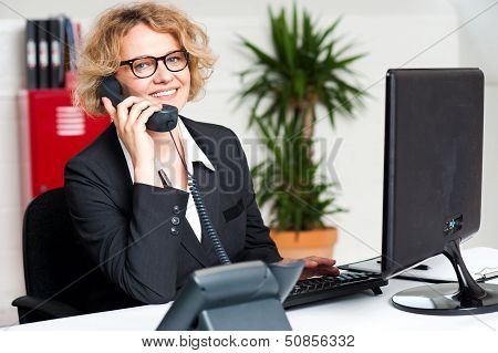 Happy Front Desk Lady Attending Clients Call
