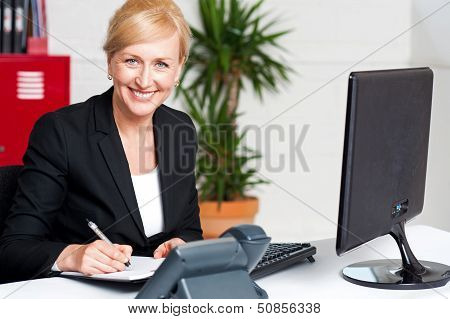 Business Executive Writing Her Appointments