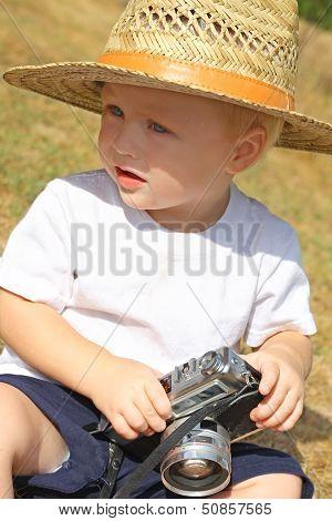 Baby Boy With Vintage Camera