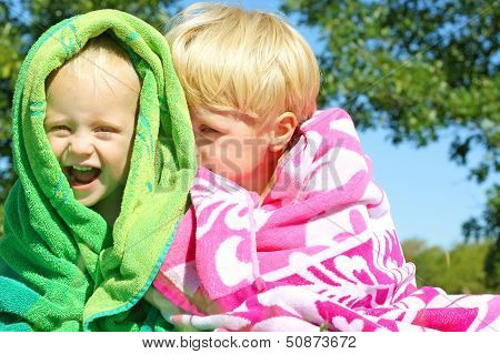 Brothers Giggling Wrapped In Beach Towels