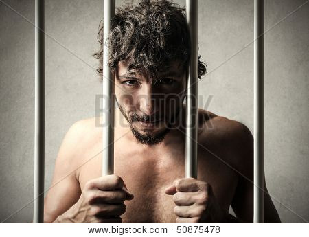 portrait of a man locked up in the prison