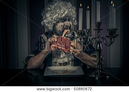 Modern prince, eating meal. Young in eighteenth century image posing with candle