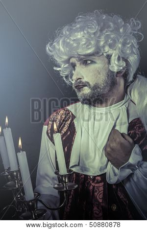 Victorian man. Young in eighteenth century image posing with candle