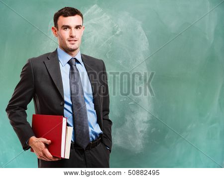 Portrait of a man in front of a chalkboard
