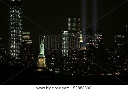 NEW YORK - SEPTEMBER 11: The Statue of Liberty is illuminated as the Tribute in Light installation is seen in lower Manhattan on September 11, 2013 in New York City.
