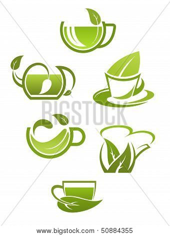 Herbal tea cups with green leaves