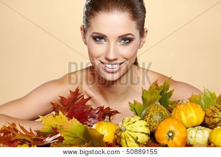 Woman with  autumn pumpkin and leaves.