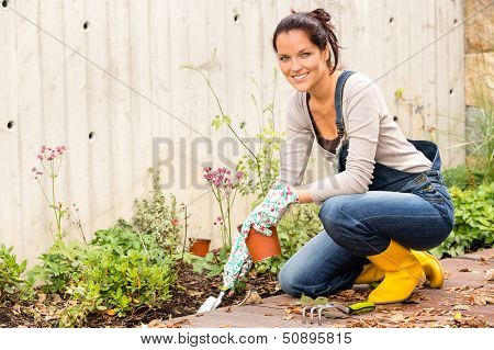 Smiling woman autumn gardening backyard housework hobby