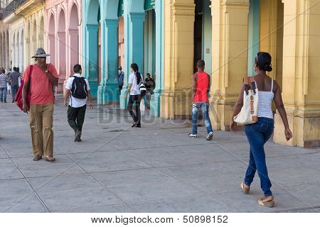 HAVANA, CUBA-SEPTEMBER 10:Cubans in a street sidelined by colorful buildings September 10,2013 in Havana.With over 2 million inhabitants, Havana is the capital of Cuba and the largest city of the Caribbean