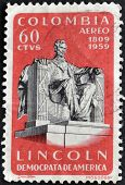 A stamp printed in Colombia shows Abraham Lincoln statue in the Lincoln Memorial in Washington DC