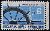 A stamp dedicated to arkansas river navigation shows ship wheel power transmission tower and barge