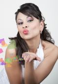 Pretty Hispanic Woman Blowing Kiss With Effects