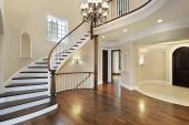 stock photo of entryway  - Foyer in new construction home with circular staircase - JPG