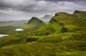 image of landslide  - Scenic view of Quiraing mountains with dramatic sky in Scottish highlands - JPG