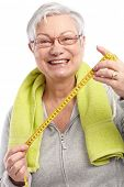 image of low-necked  - Happy old lady holding tape measure - JPG