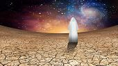 Desert and galactic sky with wandering cloaked figure some elements furnished by NASA