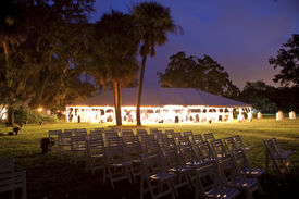 stock photo of canopy roof  - reception tent surrounded by trees - JPG