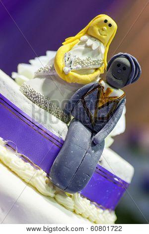 Bride And Groom Cake Toppers On A Wedding Cake Decoration