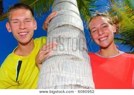 Siblings by palm tree