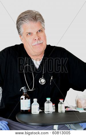 Medical Doctor With Medications Looking At Patient With Serious Expression