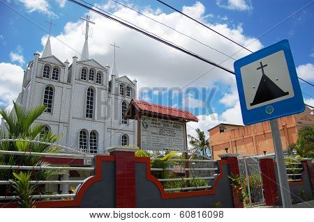Christian Church With Metal Plate Road Sign