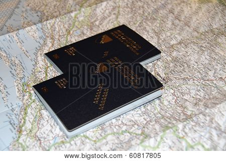 Two bosnian passports on top of a map of Europe