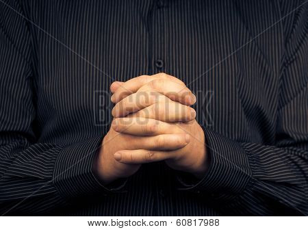 Man Wearing Shirt Folded Hands