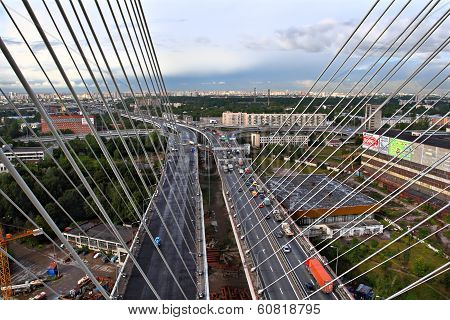 View Dominant Cable-stayed Bridge, City,  Motor Traffic, And Road Intersection