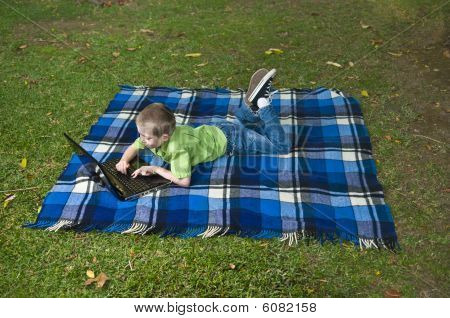 Child And Laptop In The Garden