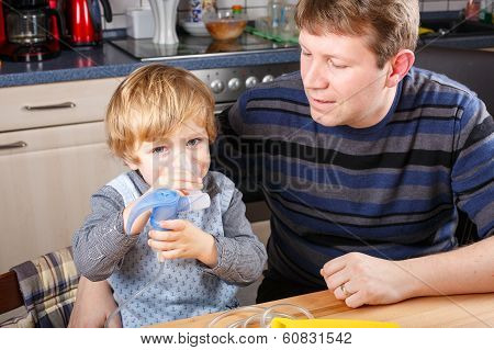 Little Boy And His Father Making Inhalation With Nebuliser