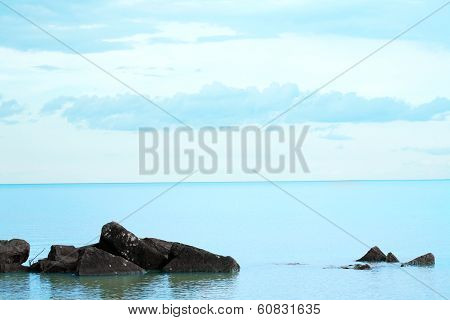 Aqua Blue Waters With Rocky Foreground
