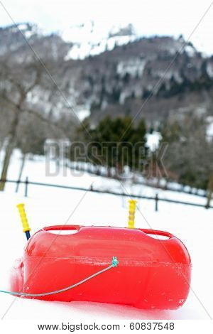 Red Bob Made Of Sturdy Plastic On White Snow For Fun Rides