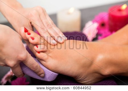 Woman Having A Pedicure Treatment At A Spa