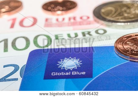 Closeup Tax Free Plastic Card From Company Global Blue Banknotes And Coins