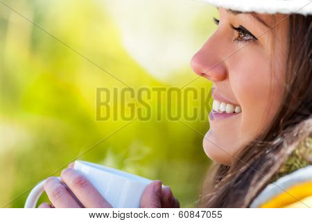 Extreme Close Up Of Girl With Coffee Mug Outdoors.