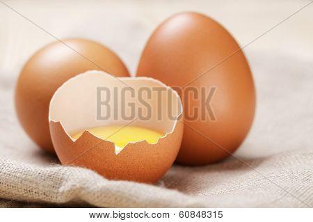 Raw Chicken Eggs One Open With Yolk