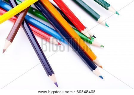 Bunch Of Colourful Pencil Crayons On White