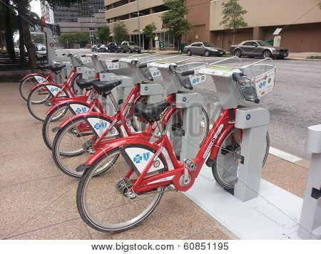 Red bicycles parked on city street
