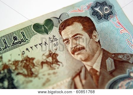 A Fifty Dinar Bill With The Face Of Saddam Hussein