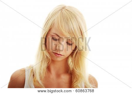 Teen girl looking below, isoalated on white background
