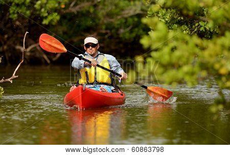 Man Paddling In A Kayak In Florida