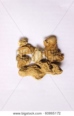 Dried ginger on an isolated background used in ayurveda medicine practice