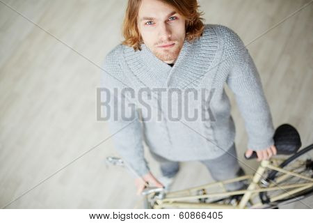 Handsome bicyclist looking at camera