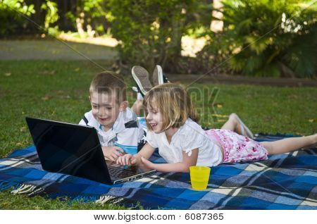 Young children with laptop