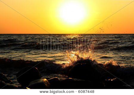 Sea splashes on sunrise