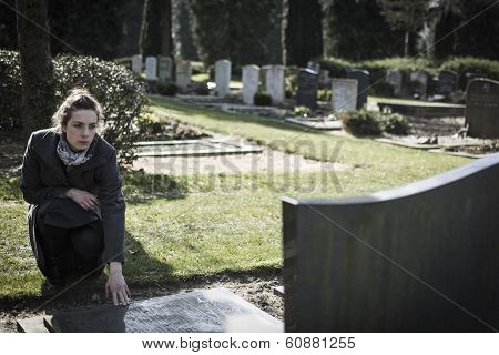 Woman sitting at grave